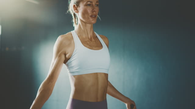 Fitness woman keeping active with jump ropes video