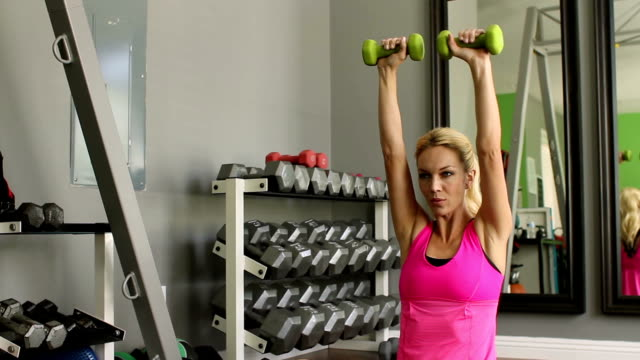 Fitness Woman Lifts Weights Track Right video