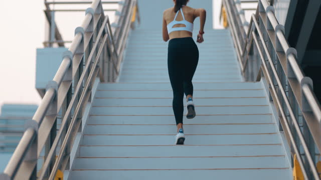Fitness woman she is running up the stairs