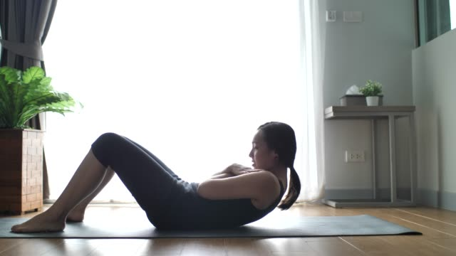 fitness woman woman exercising at home - strength training stock videos & royalty-free footage