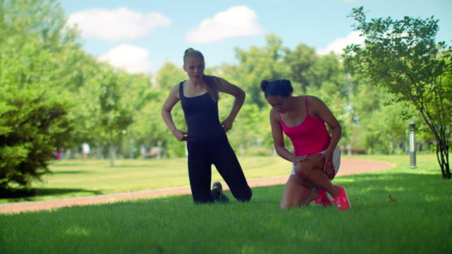 Fitness women preparing to workout outdoor. Multiracial woman breathing deep video