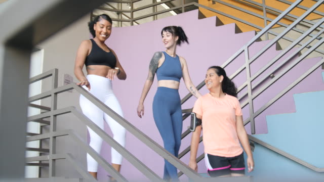 Fitness women walking down the stairs