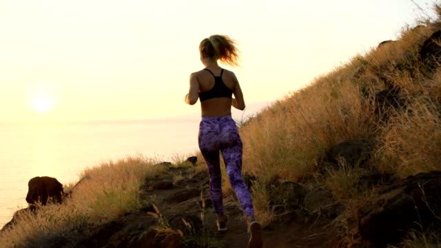Fitness Workout Outdoors. Healthy Young Woman Athlete Exercising Outside in Nature. Successful Young Woman at Sunset.
