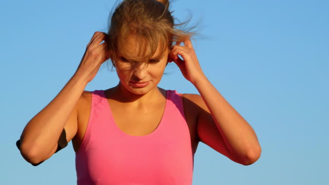 Fitness young woman at the beginning of exercise outdoors video