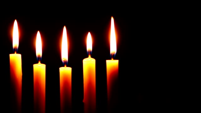 Five Candle on a Dark Background video