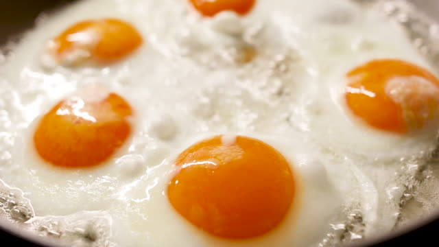 Five eggs in a pan Five eggs in a pan cooked stock videos & royalty-free footage
