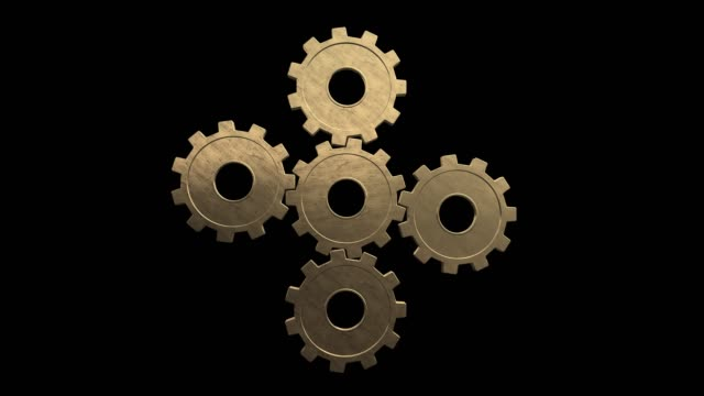 five gold gears spinning. black background. alpha channel - cinque oggetti video stock e b–roll