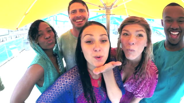 Five multi-ethnic adults at water park posing together video