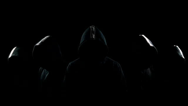 Five mysterious hooded men standing in the dark hoodies and hidden faces video