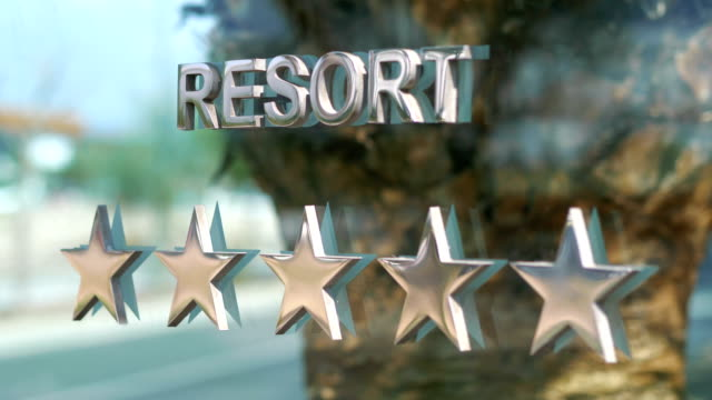 Five stars resort hotel sign in 4k slow motion 60fps Five stars resort hotel sign in 4k slow motion 60fps housing logo stock videos & royalty-free footage