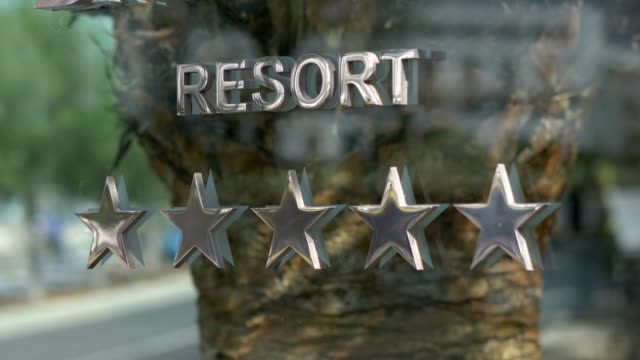 Five stars resort hotel sign in 4k slow motion 60fps video