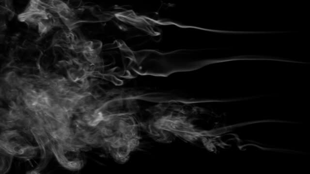 Five stream of white smoke turning into smoke puffs on a black background video