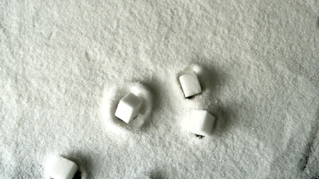 Five sugar cubes falling into pile video