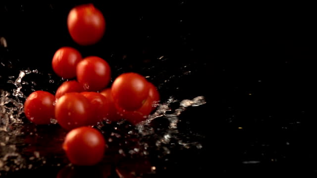 Five videos of falling cherry tomatoes in real slow motion video