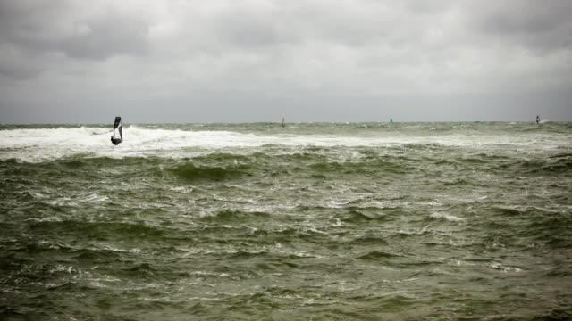 Five windsurfers in a troubled sea video