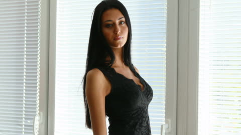 fixed side view of a sexy long haired woman fixed shot of a very attractive long haired slender Italian model in an office-like place black hair stock videos & royalty-free footage