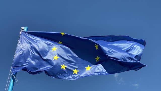 EU flag against blue sky video
