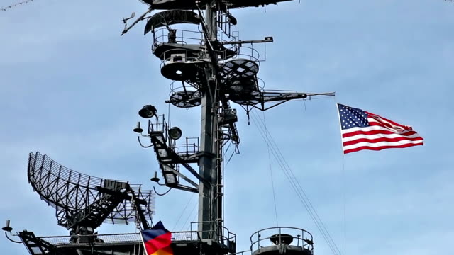 USA flag and antennas on carrier control tower video