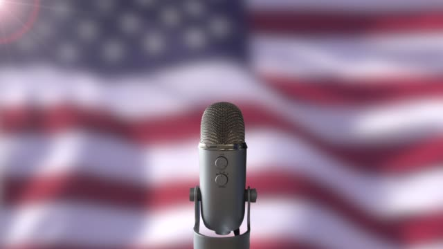 US Flag And Microphone A Microphone In Front Of A Slow Motion USA Flag Ready For A Public Address From The President president stock videos & royalty-free footage
