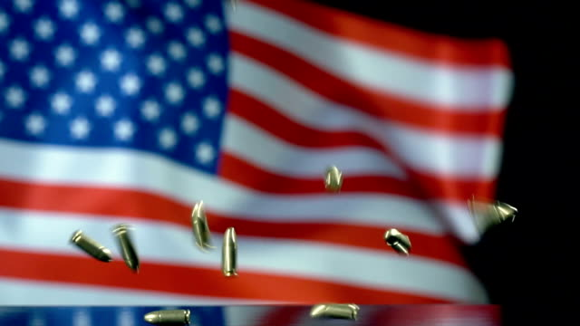 USA Flag Behind Bullets Falling In Slow Motion Full HD, Slow-Motion, 29.97 frame, Close-Up gun stock videos & royalty-free footage