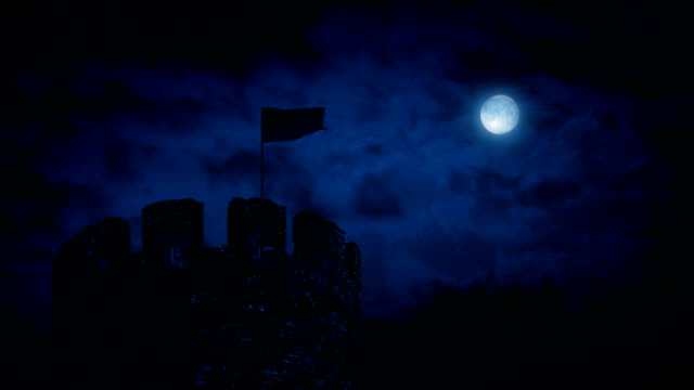 Flag Blowing On Castle Turret At Night video