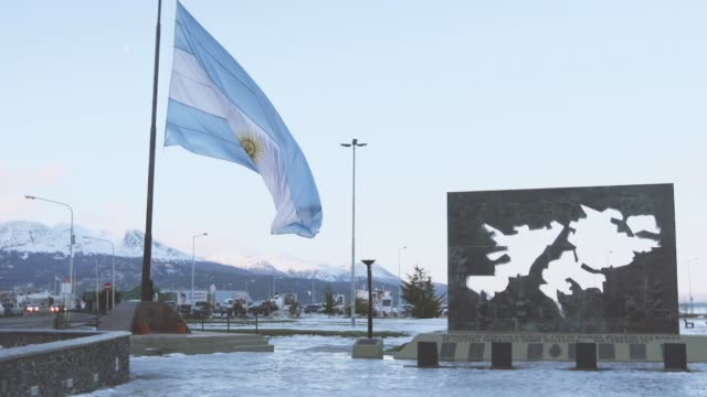 Flag of Argentina and Monument to Malvinas (Falkland Islands) in Ushuaia, Argentina.