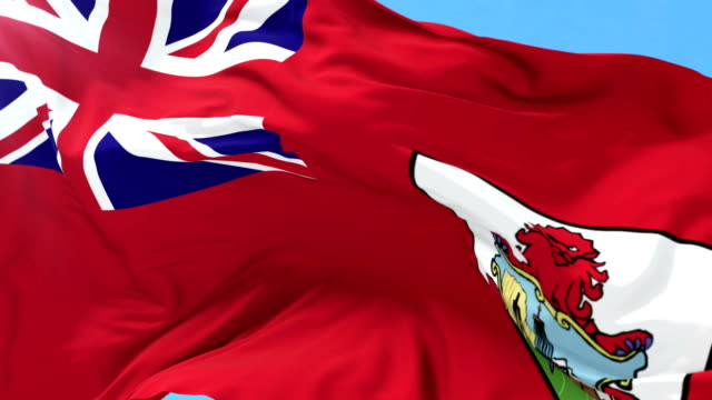 Flag of Bermuda waving at wind in slow, loop video