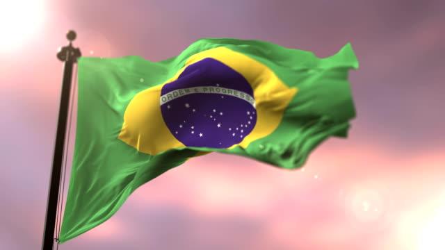 Bandeira do Brasil, acenando para o vento no lento em loop por do sol, - vídeo
