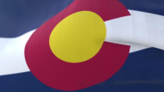 vidéos et rushes de drapeau de l'état du colorado agitant au vent, région des etats-unis - boucle - alaska état américain