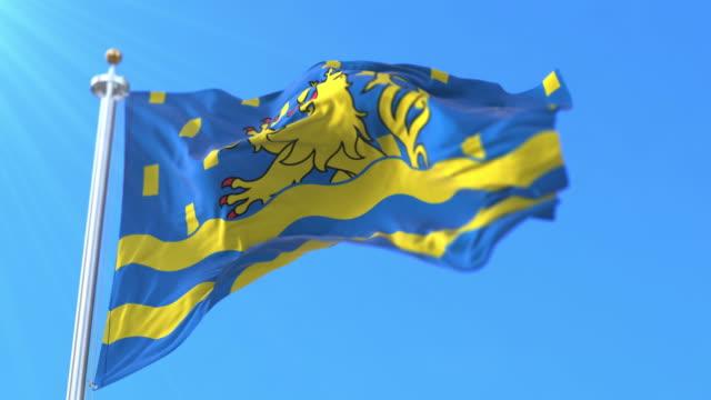 flag of department of doubs in bourgogne-franche-comté region, france. loop - formaggio comté video stock e b–roll