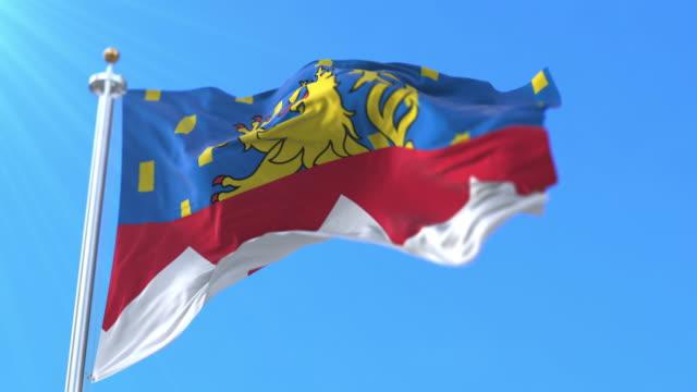 flag of department of jura in bourgogne-franche-comté region, france. loop - formaggio comté video stock e b–roll