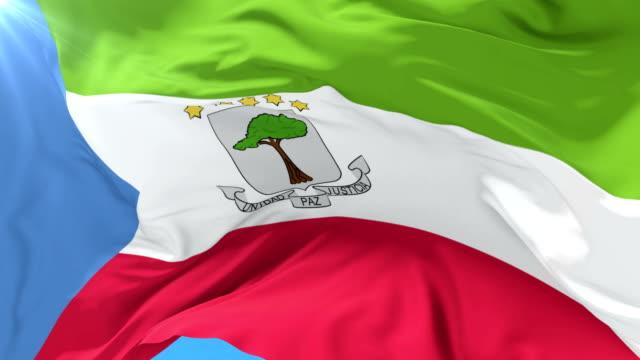 Flag of Equatorial Guinea waving at wind in slow, loop video
