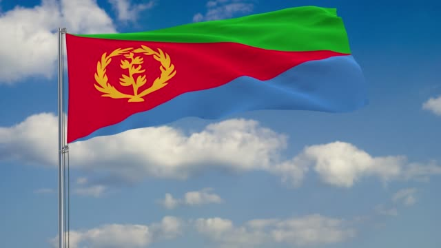 Flag of Eritrea against background of clouds floating on the blue sky Flag of Eritrea against background of clouds floating on the blue sky horn of africa stock videos & royalty-free footage