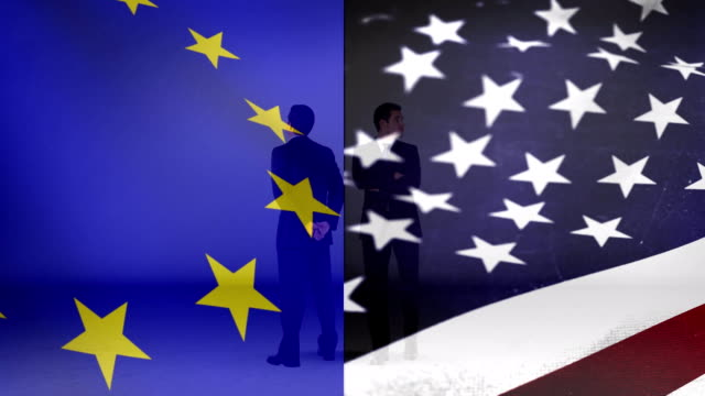 Flag of Europe beside the flag of the United States and two men