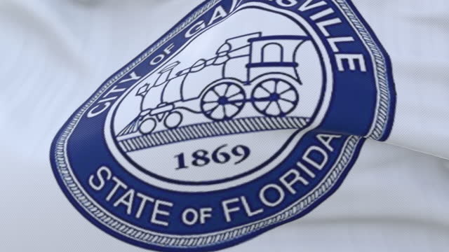 Flag of Gainesville city, in the state of Florida, United States, slow - loop Flag of Gainesville city, in the state of Florida, United States, slow - loop florida us state stock videos & royalty-free footage