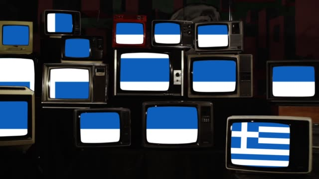 flag of greece and old vintage tvs. - grecia stato video stock e b–roll