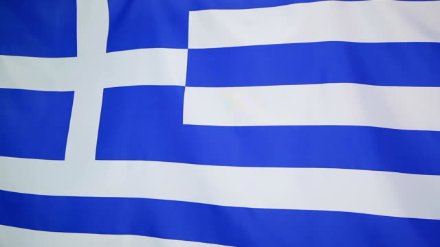 flag of greece in slow motion - grecia stato video stock e b–roll