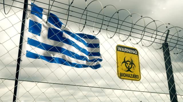 Flagge von Griechenland mit Biohazard Zeichen Warnung vor Quarantäne. Loopable. – Video