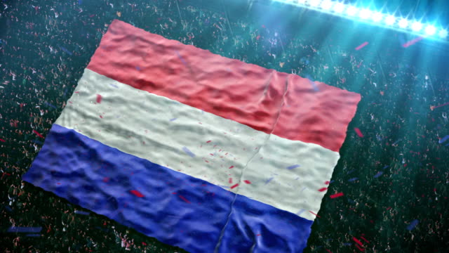 Flag of Holland at the stadium Fans of the Holland football team unfurl a giant flag in the stands at the stadium.  HD video footage. netherlands stock videos & royalty-free footage