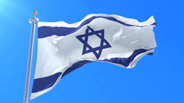 Flag of Israel waving at wind with blue sky in slow, loop video