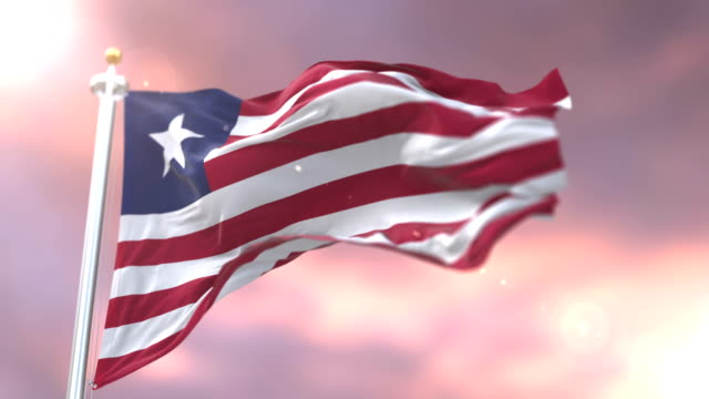 flag of liberia waving at wind at sunset in slow, loop - liberia video stock e b–roll
