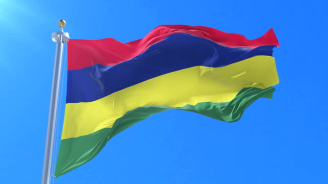 flag of mauritius waving at wind with blue sky in slow, loop - isole mauritius video stock e b–roll