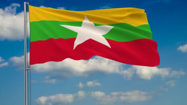 flag of myanmar against background of clouds floating on the blue sky - naypyidaw video stock e b–roll