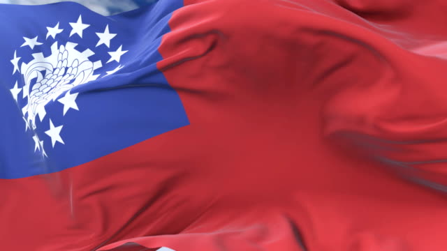 flag of myanmar or union of burma waving at wind in slow, loop - naypyidaw video stock e b–roll