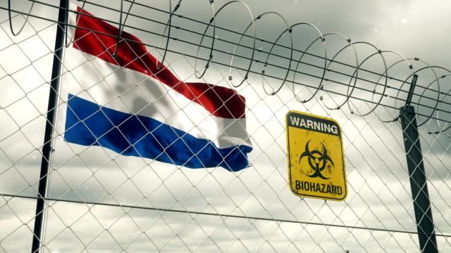 Flagge der Niederlande mit Biohazard Zeichen Warnung vor Quarantäne. Loopable. – Video