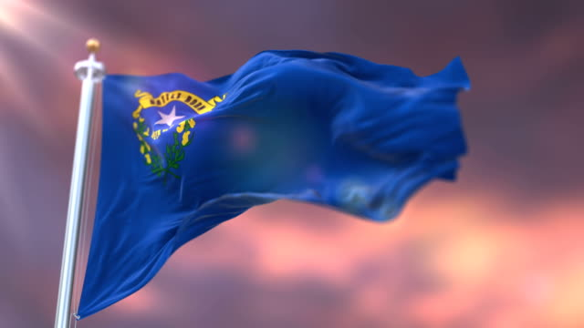 flag of nevada state at sunset, region of the united states - loop - nevada video stock e b–roll