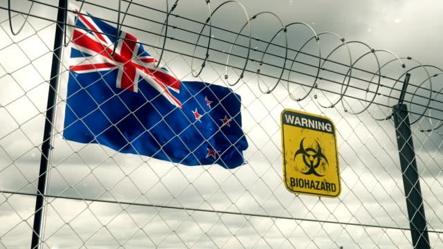 Flagge von Neuseeland mit Biohazard Zeichen Warnung vor Quarantäne. Loopable. – Video