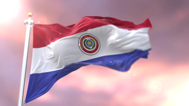 flag of paraguay waving at wind at sunset in slow, loop - парагвай стоковые видео и кадры b-roll