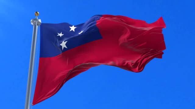 Flag of Samoa waving at wind in slow with blue sky, loop video