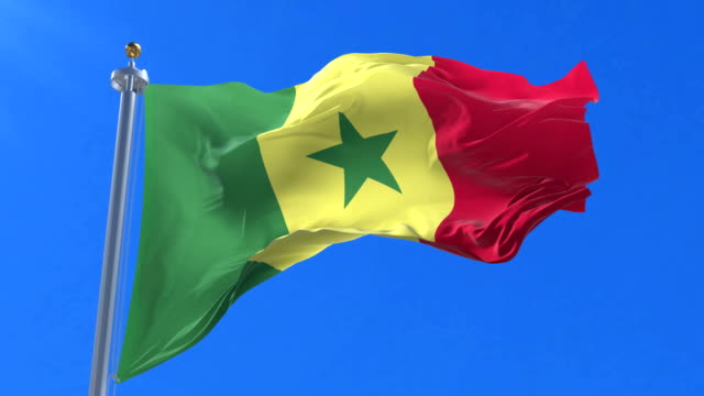 flag of senegal waving at wind in slow with blue sky, loop - dakar video stock e b–roll